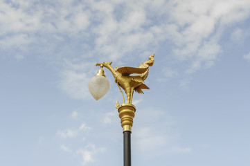 Golden swan lamp on street