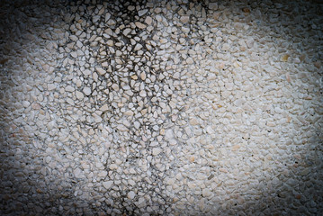Texture of cement wall apply with pebble