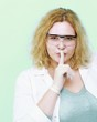chemist woman showing silence gesture isolated