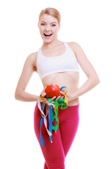 Sporty fit woman with measure tapes fruit.
