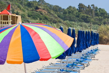 Beach umbrellas and big colorful umbrella