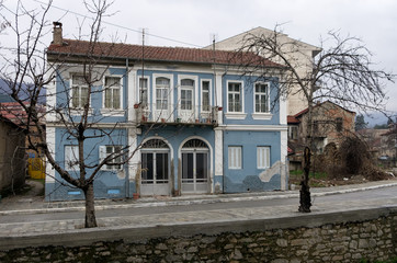 Old neoclassical building by the river in Florina, Greece