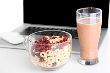 Composition with laptop and healthy breakfast, isolated on