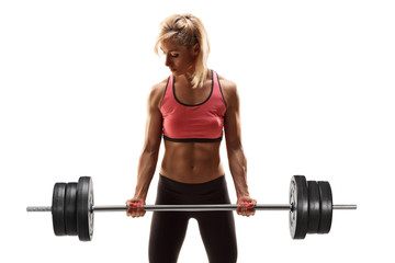Strong woman lifting a heavy weight