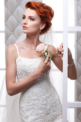 sexual beautiful bride in a wedding-dress is in fashion style