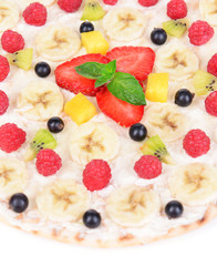 Sweet pizza with fruits close-up