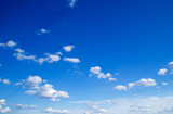 blue sky background with tiny clouds poster