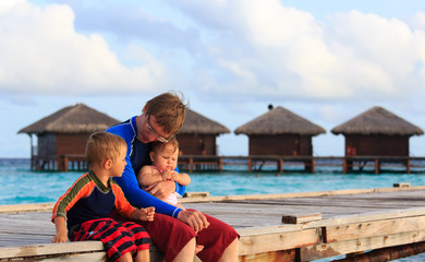 father with kids on tropical vacation