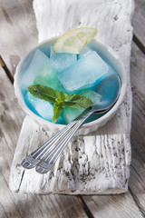 Bowl of colored ice-cubes