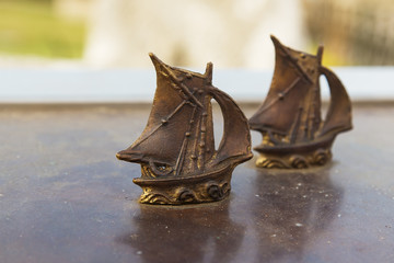 statuette metal sailboat