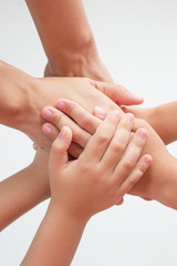 Family hands connected together on isolated background