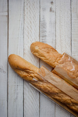 French bread on the wooden background