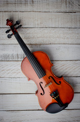 Old Classic violin vintage on the wooden background