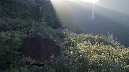 Slow Flight over rocks on sunrise