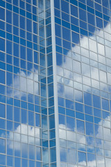 Glass building with cloud reflections
