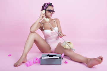 Girl in lingerie talking on an old phone