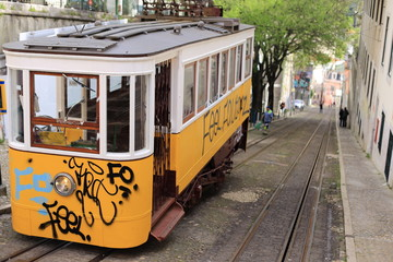 Yellow tram with graffity in lisbon