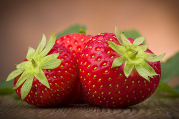 Fresh Strawberry close up on the wood
