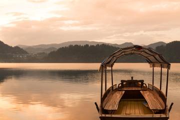 Touring boat on famous Lake Bled, Slovenia at sunset