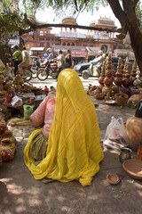 woman draped in yellow saree , Rajasthan, India