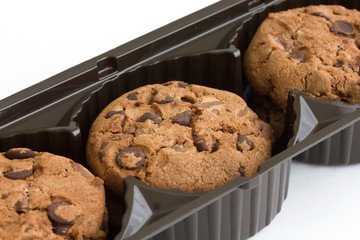 Commercial chocolate chip cookies in plastic tray.
