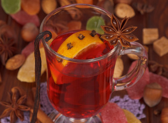 Cup of mulled wine closeup and various spices