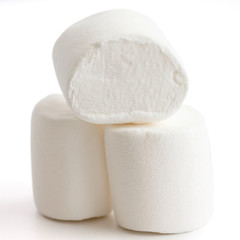 Three marshmallows stacked and isolated on white.