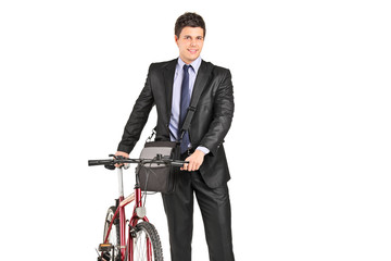 Young businessman pushing a bike