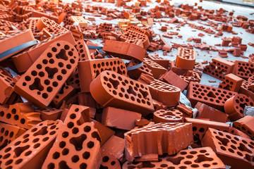 Pile of new intact and beaten bricks