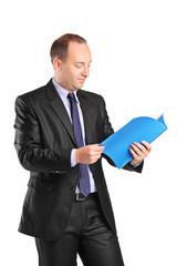 Vertical shot of a businessman reading a document