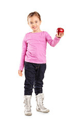 Cute little girl holding an apple