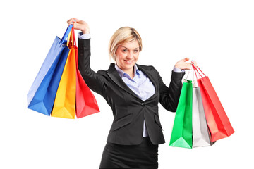 Businesswoman holding shopping bags