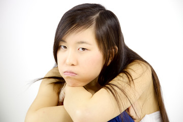 Disappointed asian girl looking angry