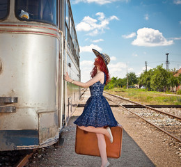 Beautiful woman with blue dress on a train station.