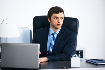 Office worker working on laptop in office