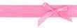 Pink polka dot ribbon with a bow