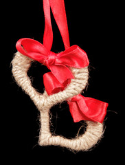 Homemade fabric hearts hanging on red ribbon