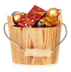 Christmas decorations in wooden bucket