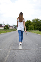 Young woman walking outdoor