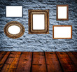 Retro room with antique picture frames on stone wall