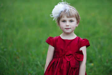 Little princess in red dress.