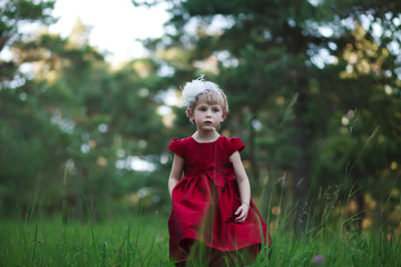 sad little princess in red dress