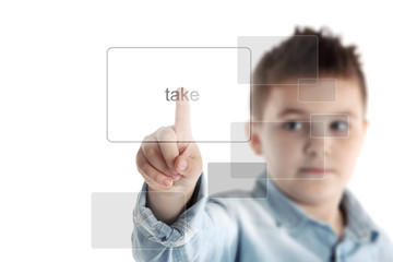Take. Boy pressing a button on a virtual touchscreen.