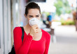 Woman wearing mask coughing