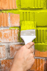 Orange brick wall painted with yellow color