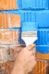 Orange brick wall painted with light blue color