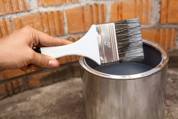Close-up view of painting brush stained grey color