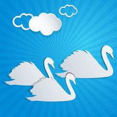 White paper swans and clouds