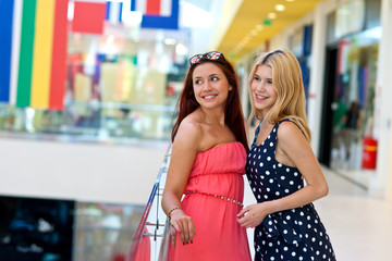 two woman friends in shopping mall