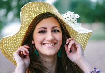 Young woman in straw hat smiling